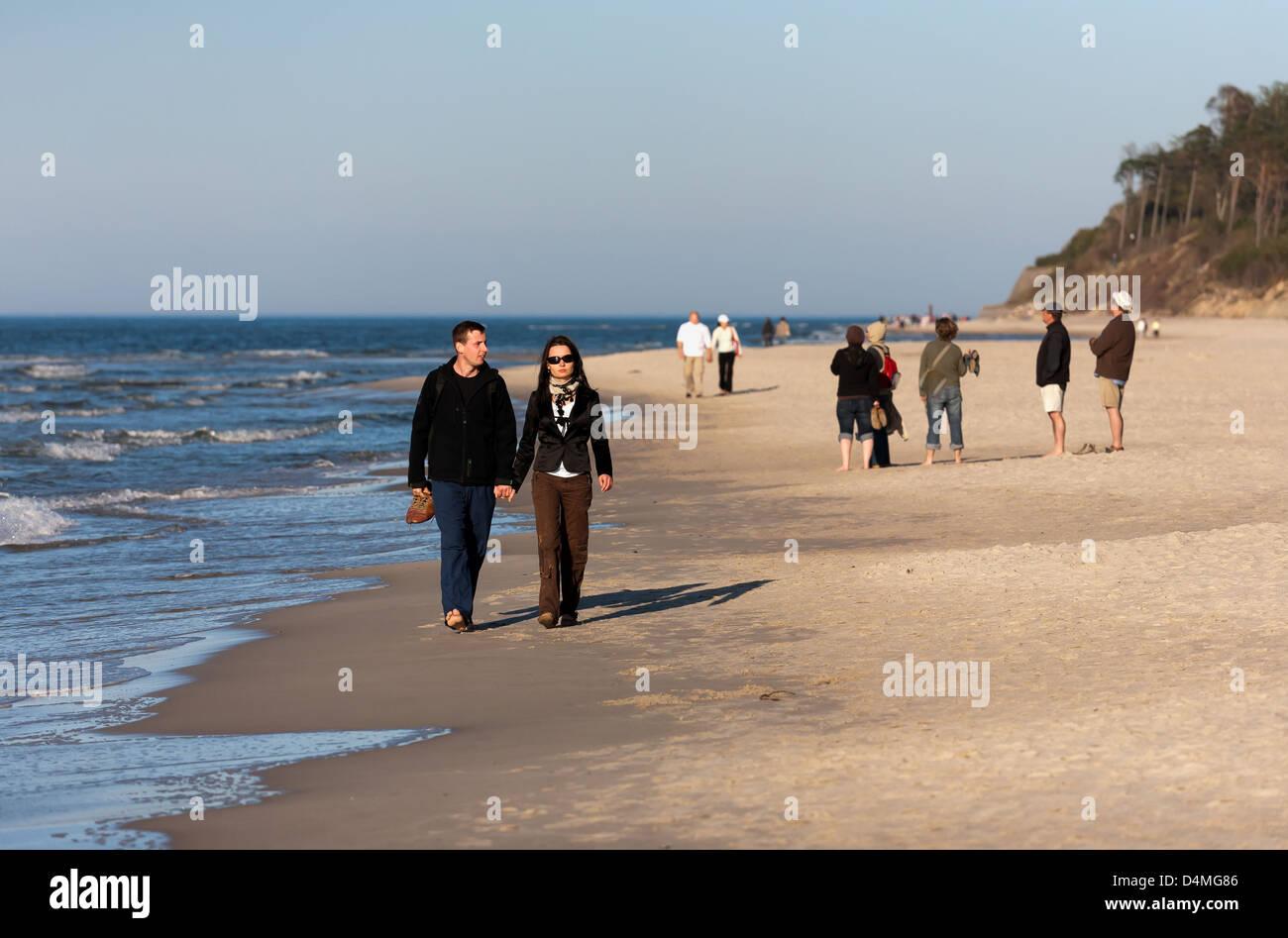 Ostrava, Poland, tourists walk on the Baltic Sea beach - Stock Image