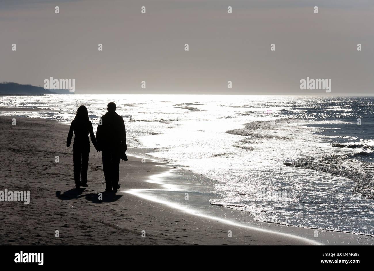 Ostrava, Poland, lovers stroll on the Baltic beach - Stock Image
