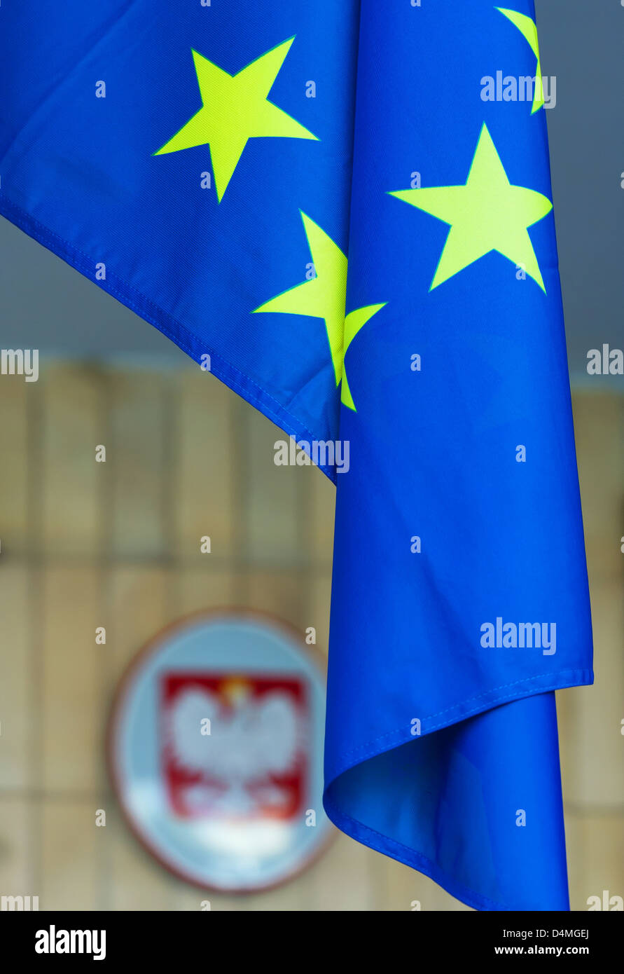 Opole, Poland, EU flag and coat of arms of Poland at the seat of self-government of the Opole - Stock Image