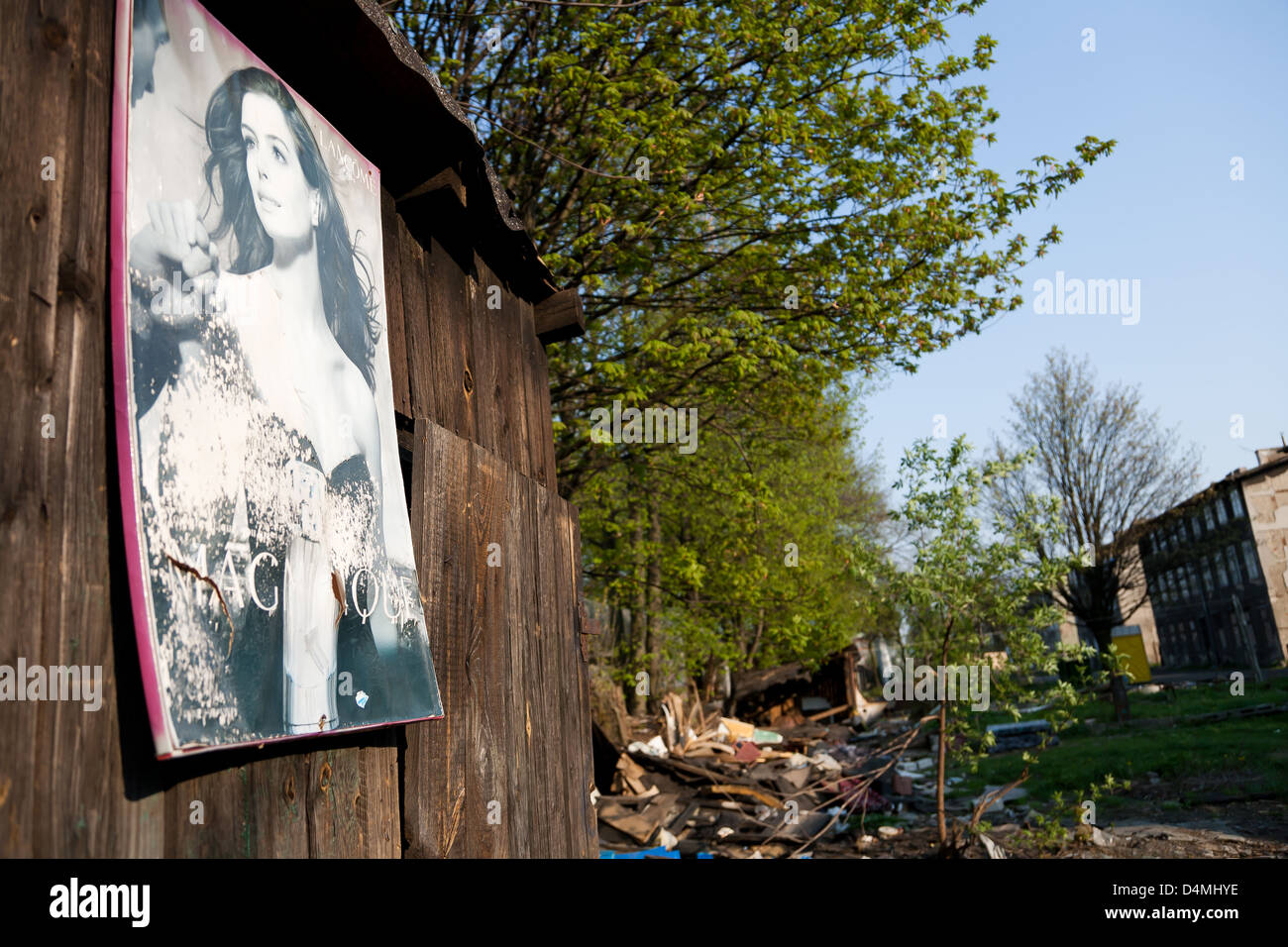 Gdansk, Poland, faded perfume advertisement on the grounds of a dilapidated housing estate - Stock Image
