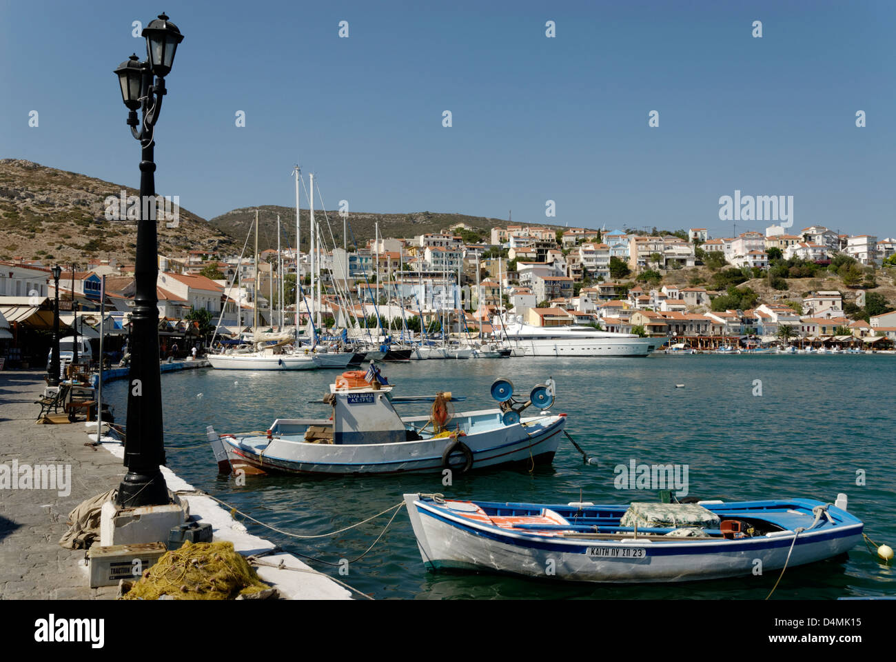Samos. Greece. Colourful fishing boats docked in the pretty harbour of Pythagoreio. Stock Photo
