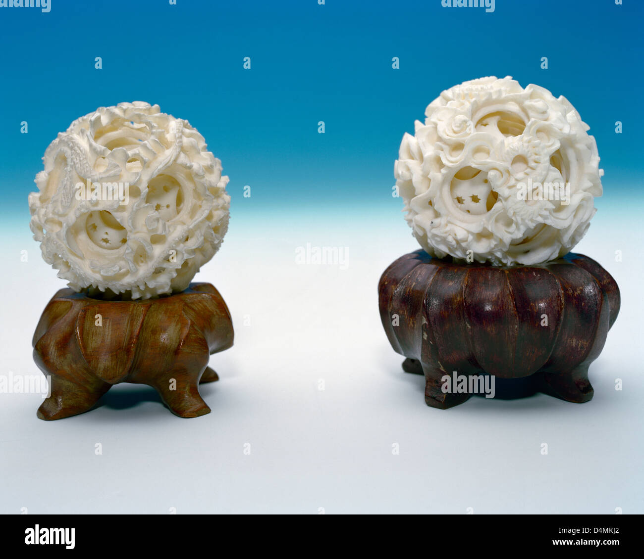 Chinese carved ivory concentric balls on rosewood stands - Stock Image