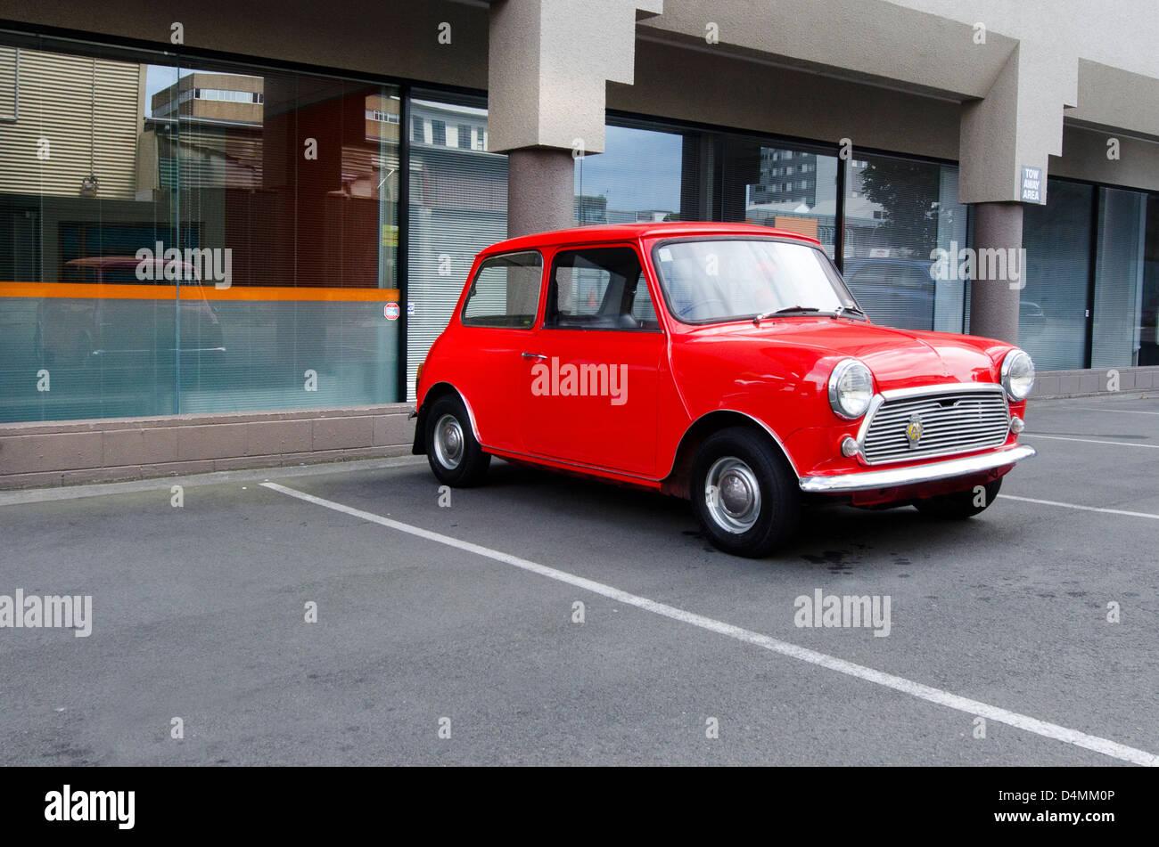 Classic mini model in a car parking lot. - Stock Image
