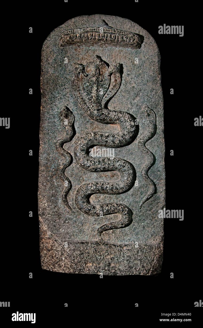 Snake Cobra Pregnant fertility desiring conceive Nagakkal stone stones India Hindu - Stock Image