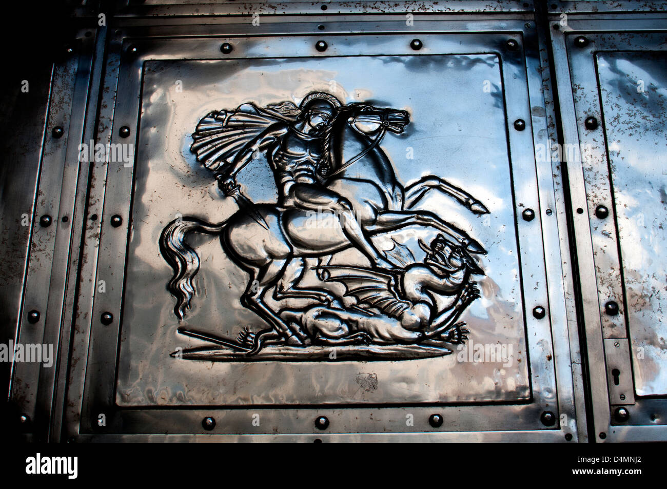 Saint George and the dragon detail of metal door on NatWest Bank, Coventry, UK - Stock Image