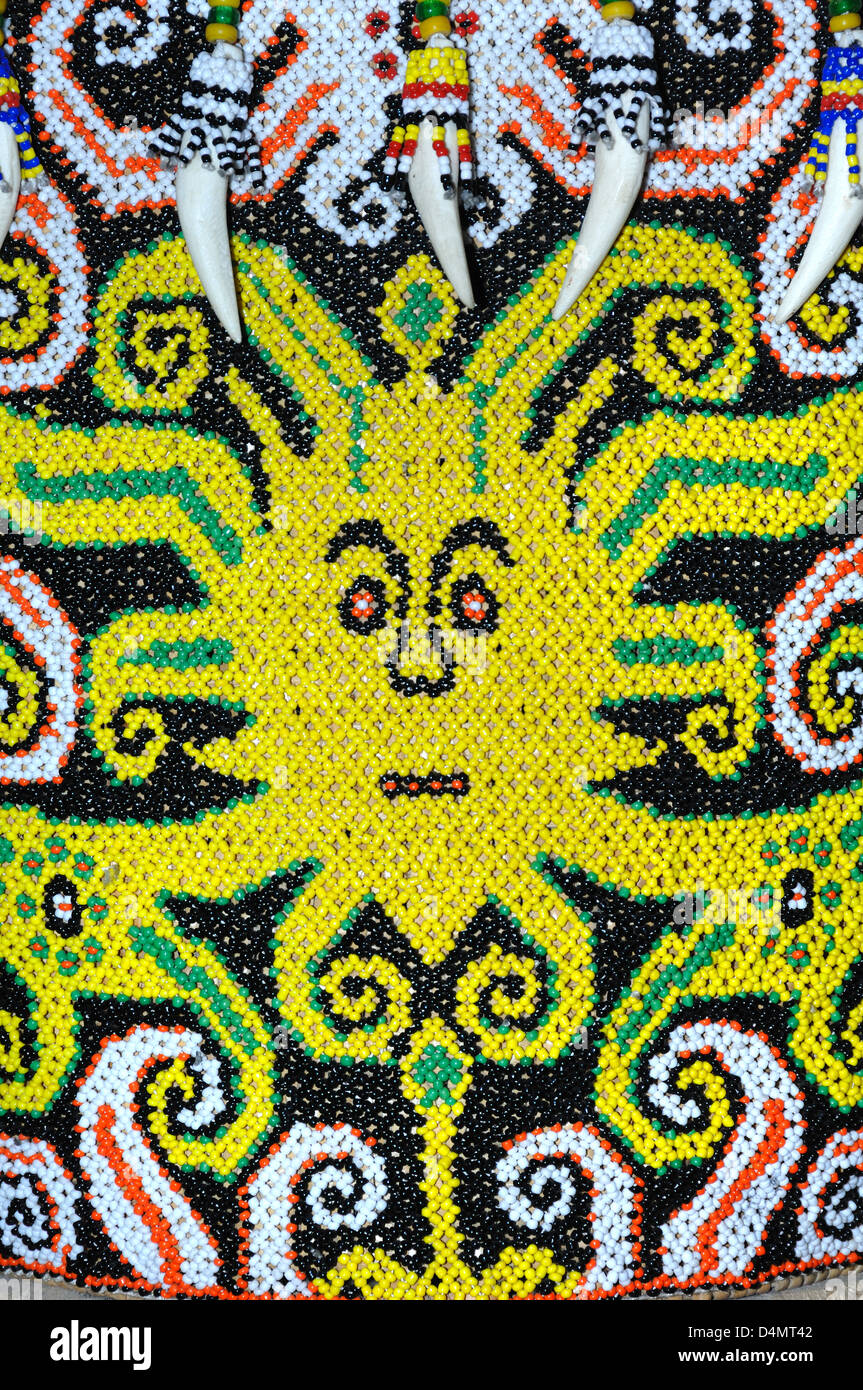 Orang Ulu Tribal Art or Primitive Face or Figurative Design Sarawak Borneo Malaysia - Stock Image