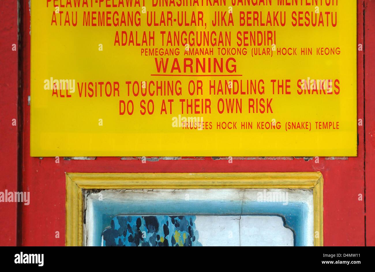 Beware of Snakes Warning Sign at Snake Temple or Hock Hin Keong Temple Penang Malaysia - Stock Image