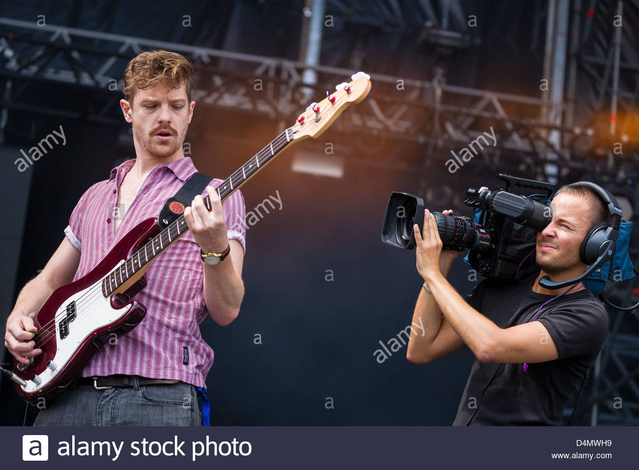 Bass guitar player performing live - Stock Image