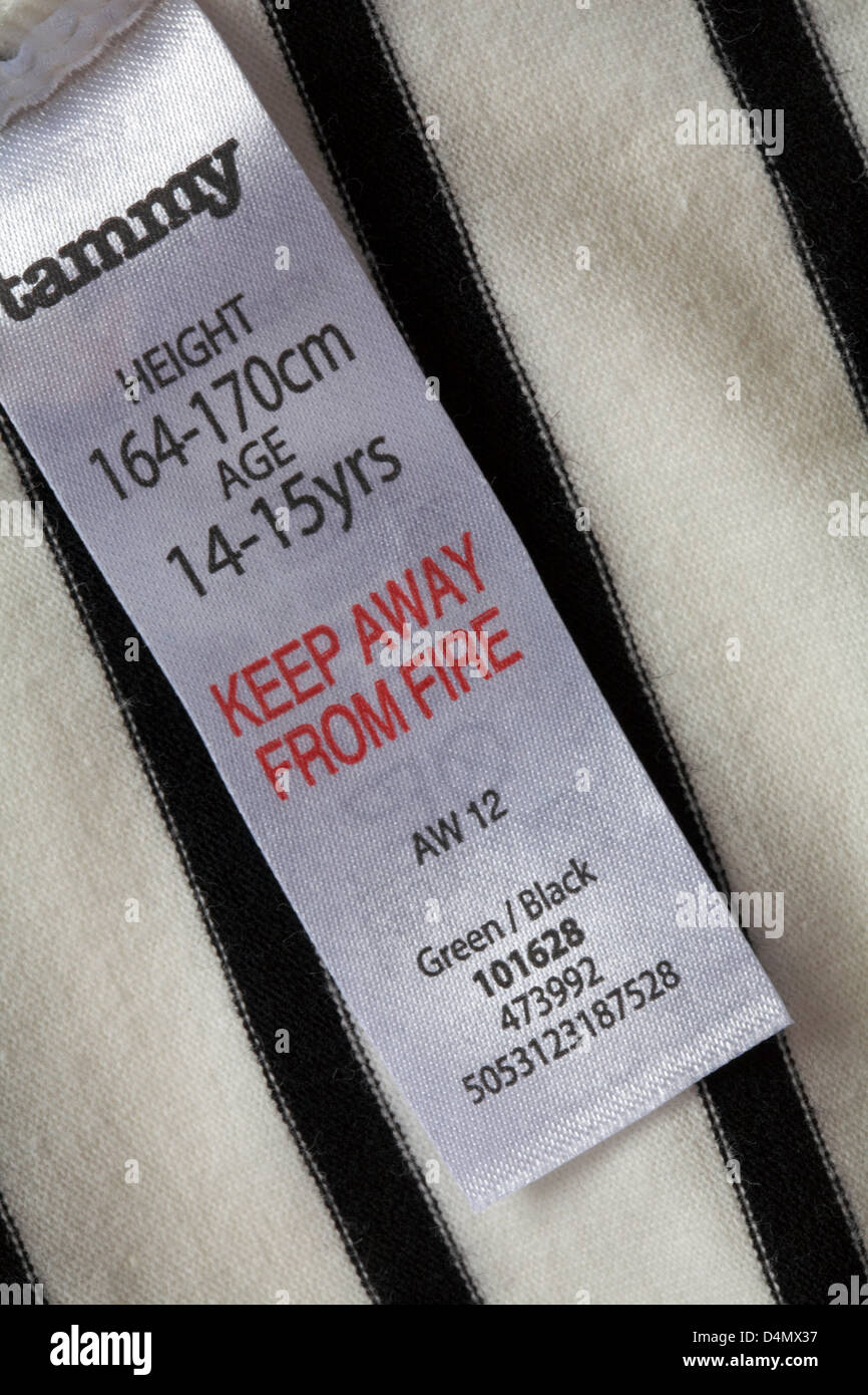 label in girl's top - Tammy height 164-170 cm age 14-15 yrs keep away from fire - Stock Image