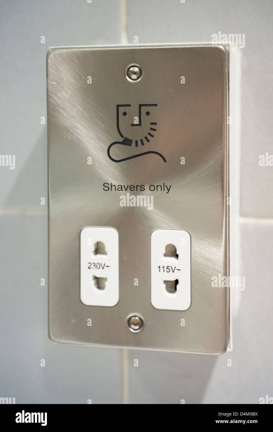 Electric shaver socket and charging point. - Stock Image