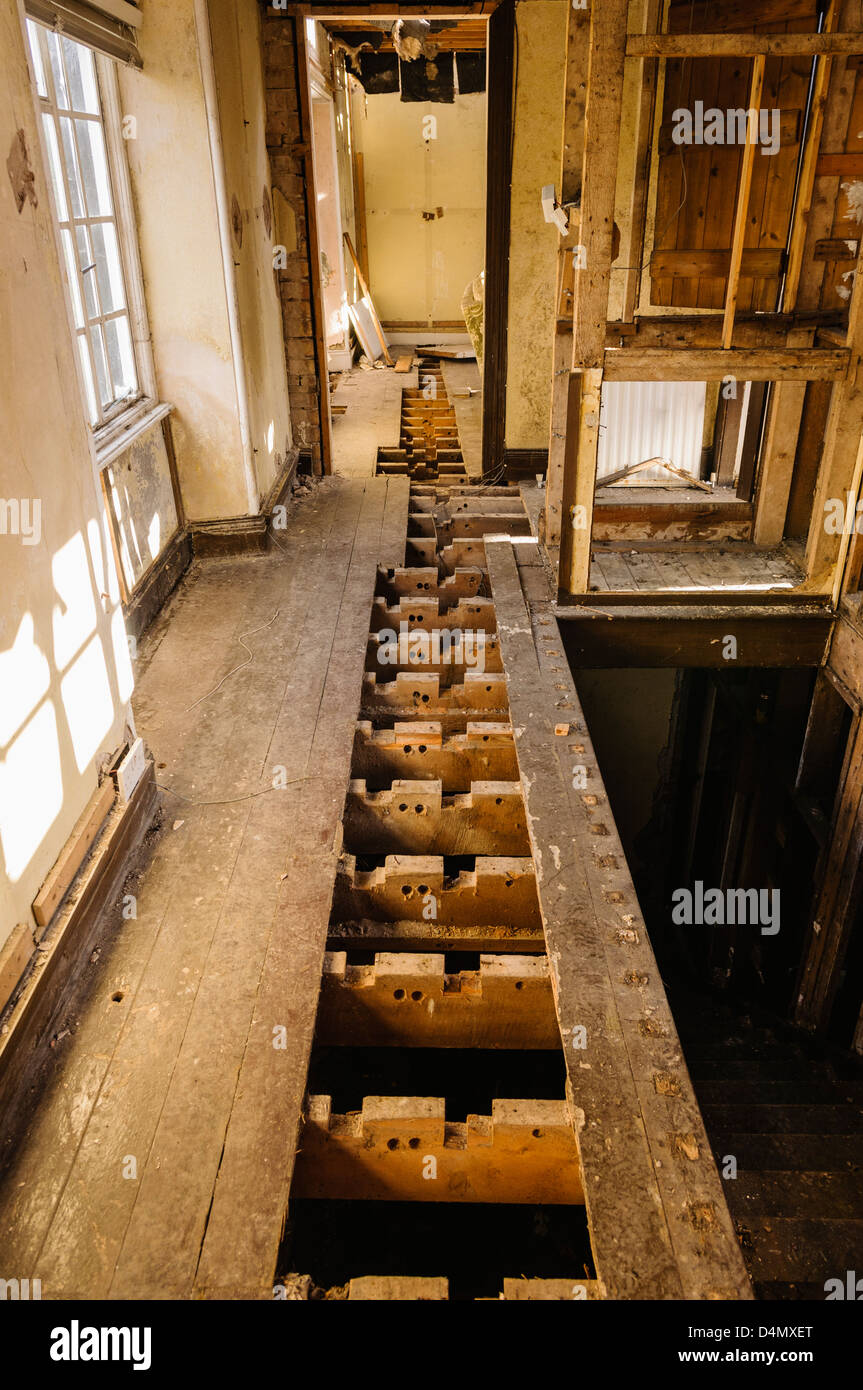 Thieves steal copper pipes from an empty house. - Stock Image