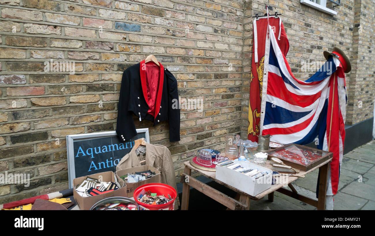 Display of militaria & Union Jack flag outside Aquamarine Antiques shop in Camden Passage Islington London  - Stock Image
