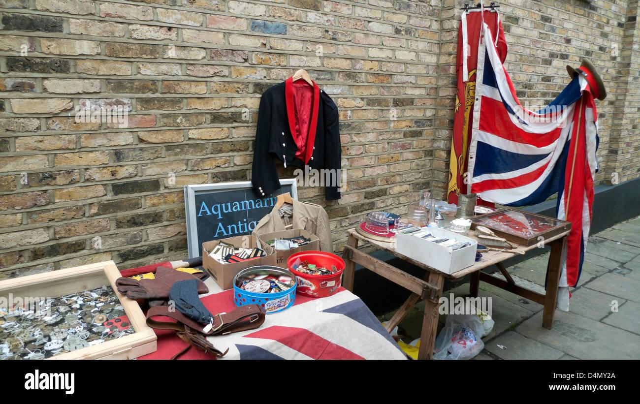 Display of militaria & Union Jack flag outside Aquamarine Antiques shop in Camden Passage Market Islington London - Stock Image