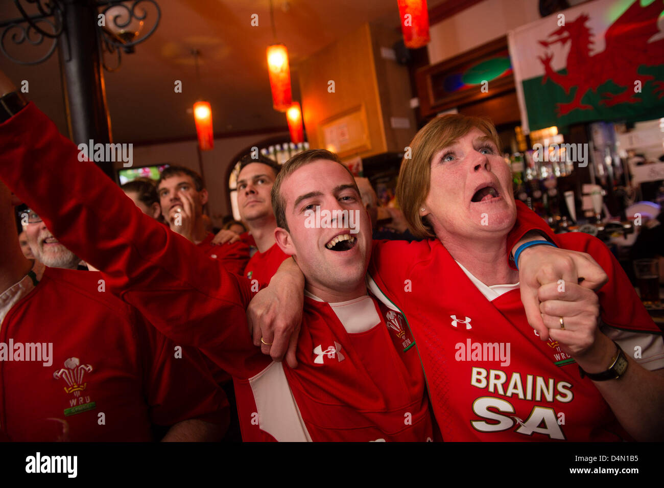 Aberystwyth, Wales, UK. Saturday 16 March 2013.  Scores of Welsh rugby fans crowd in to the Castle Hotel pub in - Stock Image