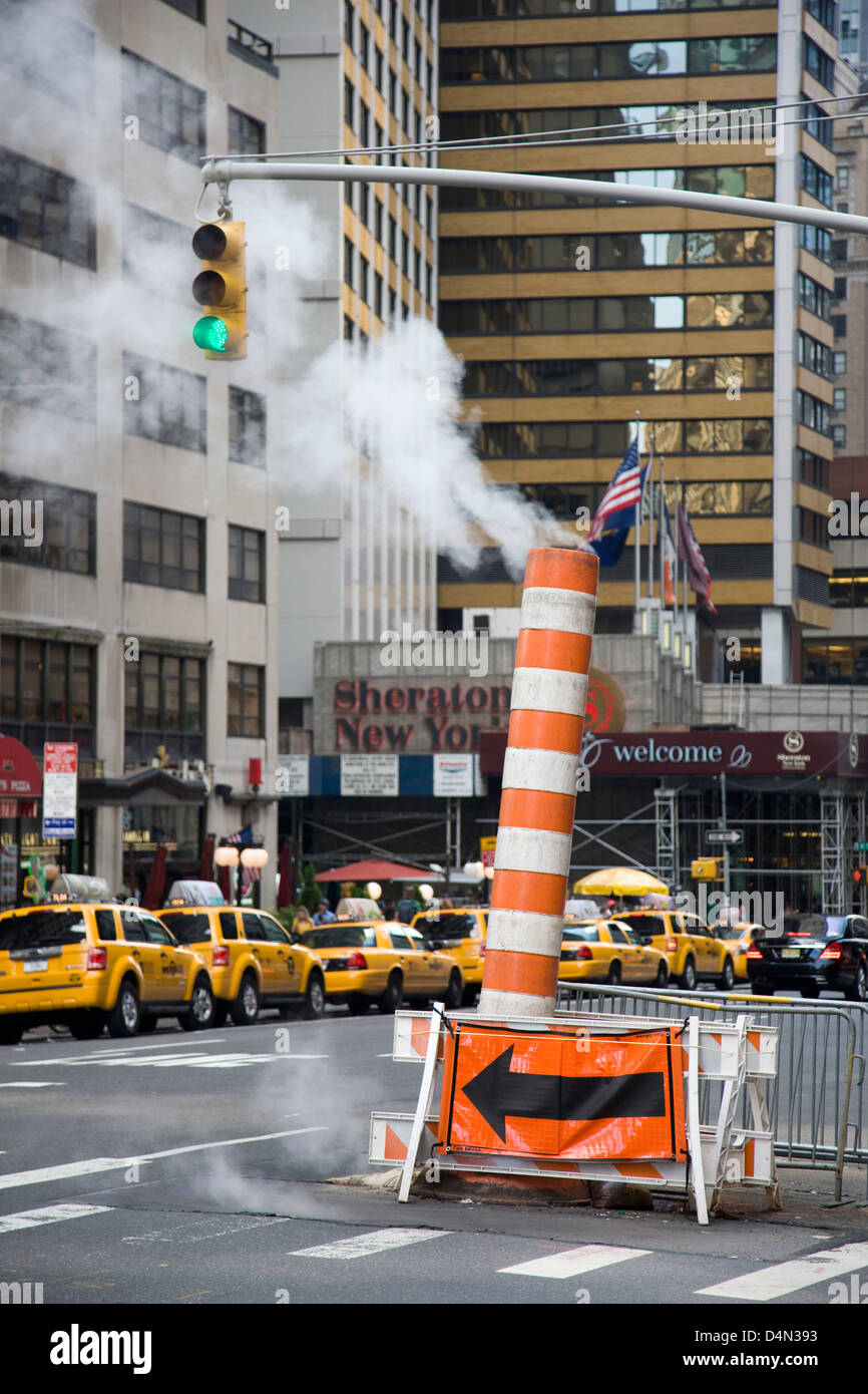 Steam chimney vent in the street in New York - Stock Image