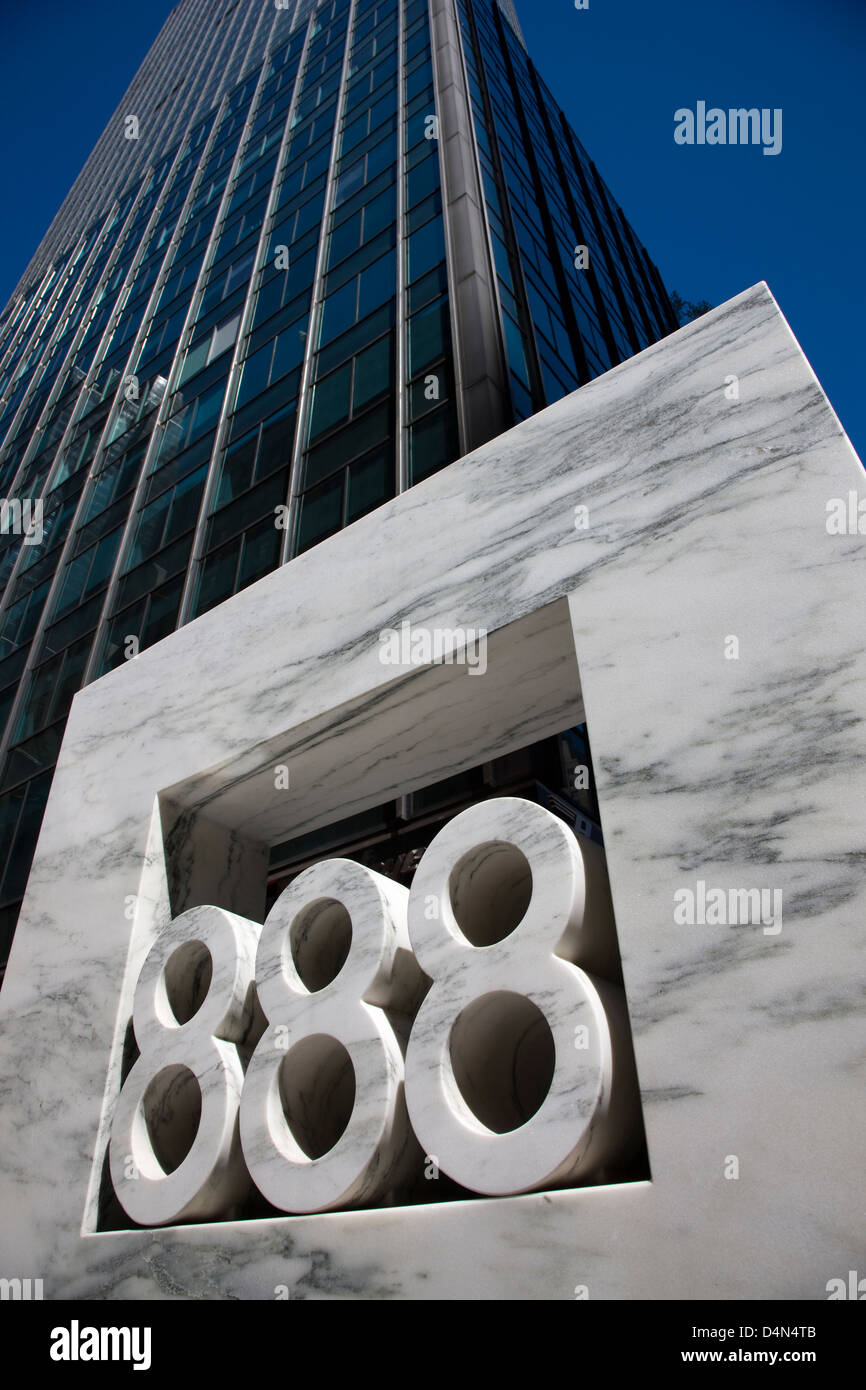 The large carved marble street number sign of 888 7th Avenue in New York - Stock Image