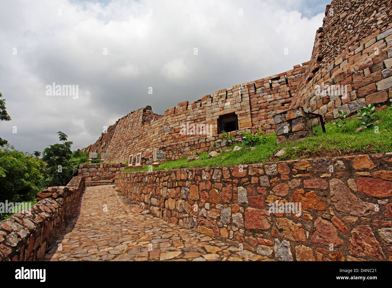 Tughlaqabad Fort is a ruined fort in Delhi, built by Ghiyas-ud-din Tughlaq, the founder of Tughlaq dynasty, in 1321 - Stock Image