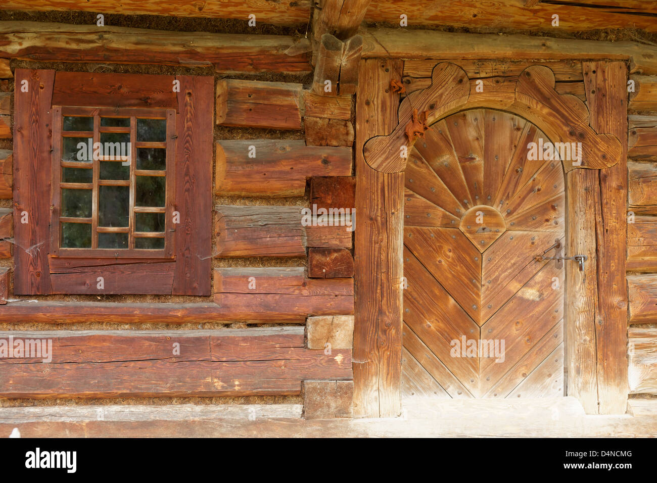 Door and window of peasants house, Orawa Ethnographic Museum, Malopolska, Poland - Stock Image