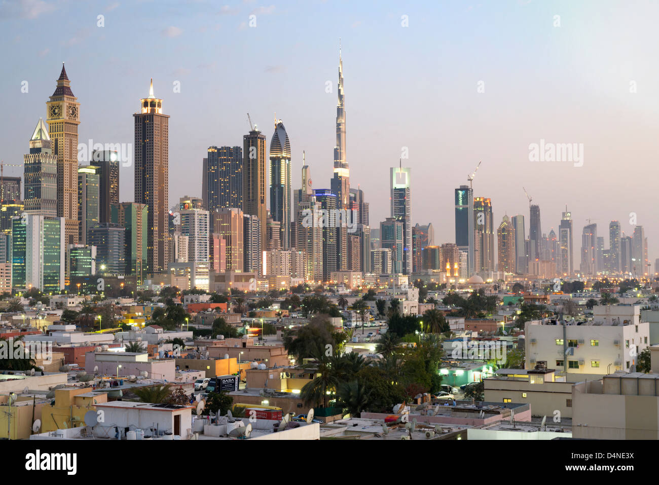 Evening view across old Al Satwa district towards modern skyline of Dubai with skyscrapers in United Arab Emirates - Stock Image