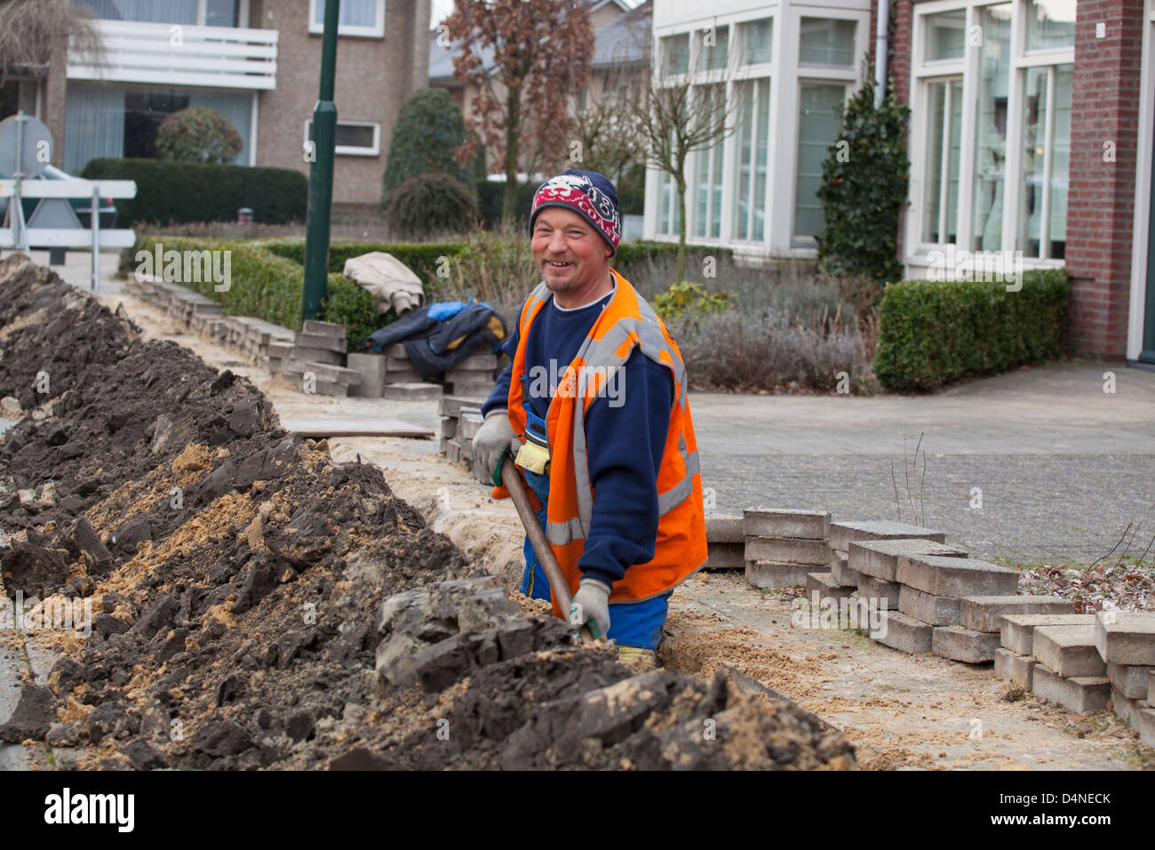 Hungarian migrant worker digging for the construction of a glass fiber network in the Netherlands. Stock Photo