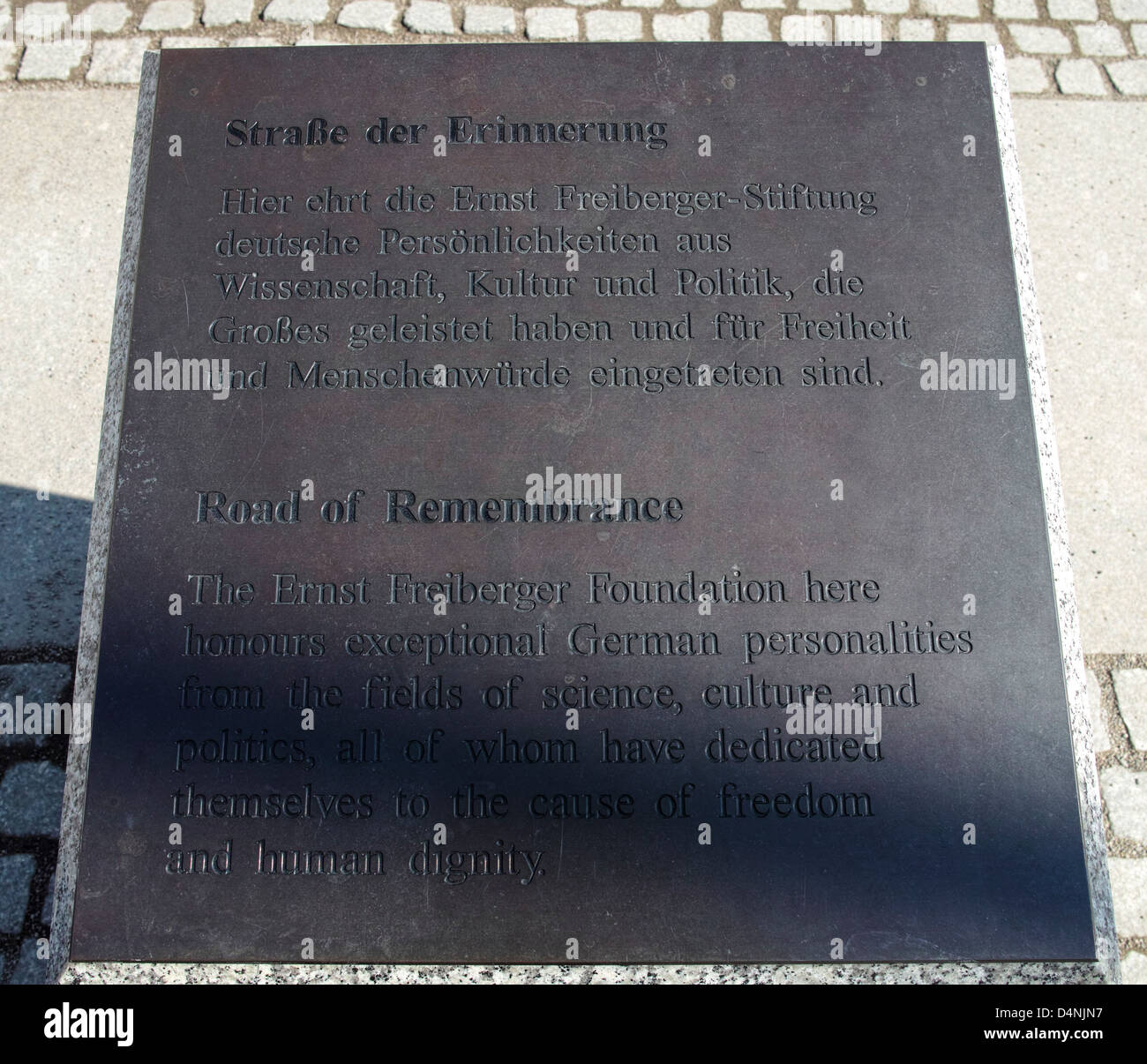 Info sign a the entrance to Strasse der Erinnerung (Road of Rememberance) alley in Berlin. - Stock Image