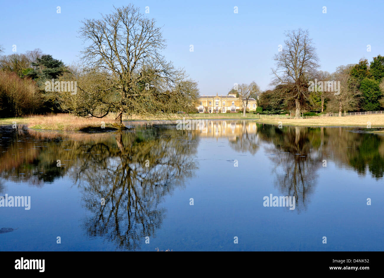 Chilterns Great Missenden the abbey across lake formed by river Misbourne - brilliant winter sunlight still water - Stock Image