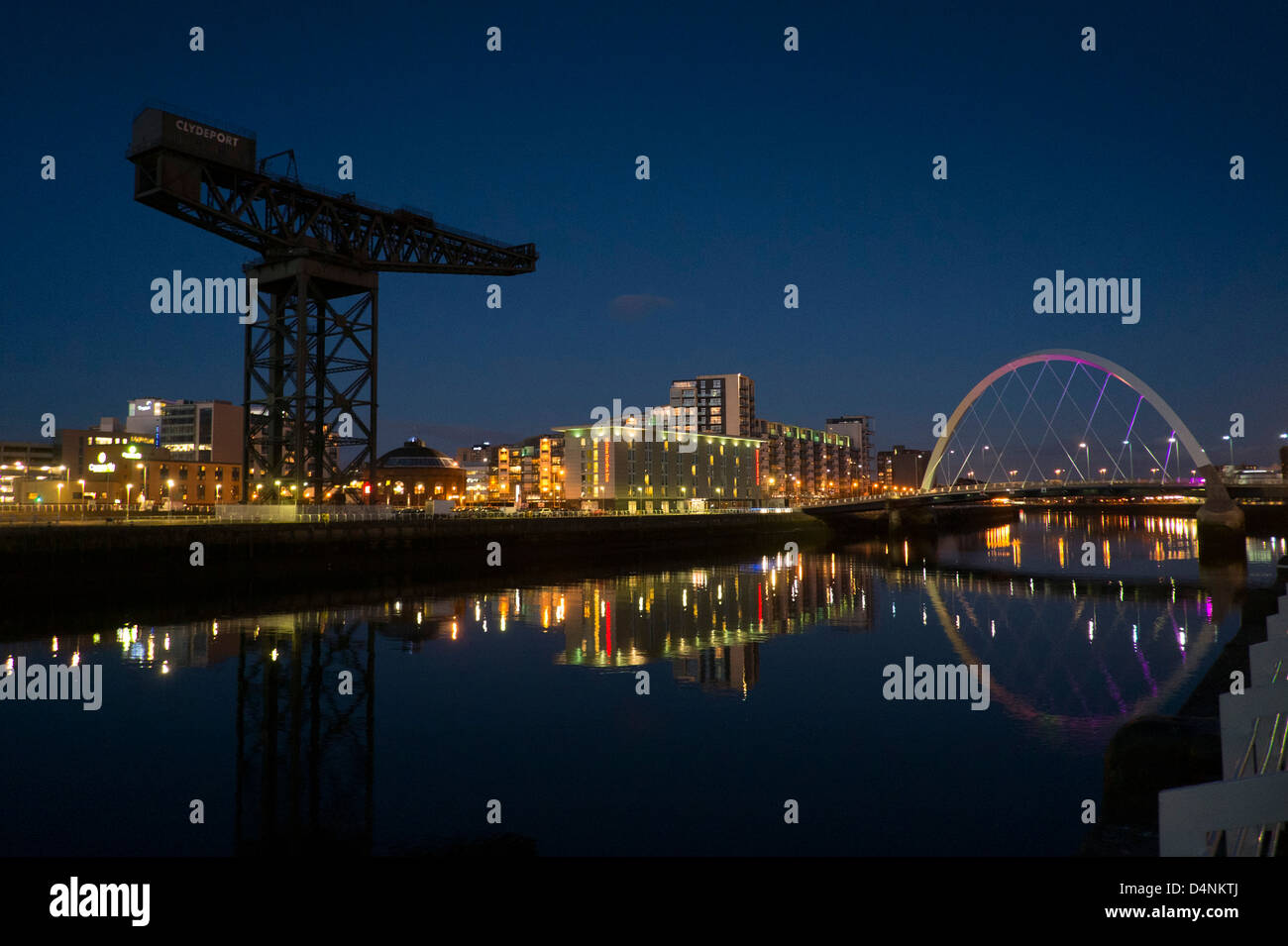 A night time view of the river Clyde, showing the Finnieston Crane the Clyde arc and the Hilton Garden Inn, Glasgow Stock Photo