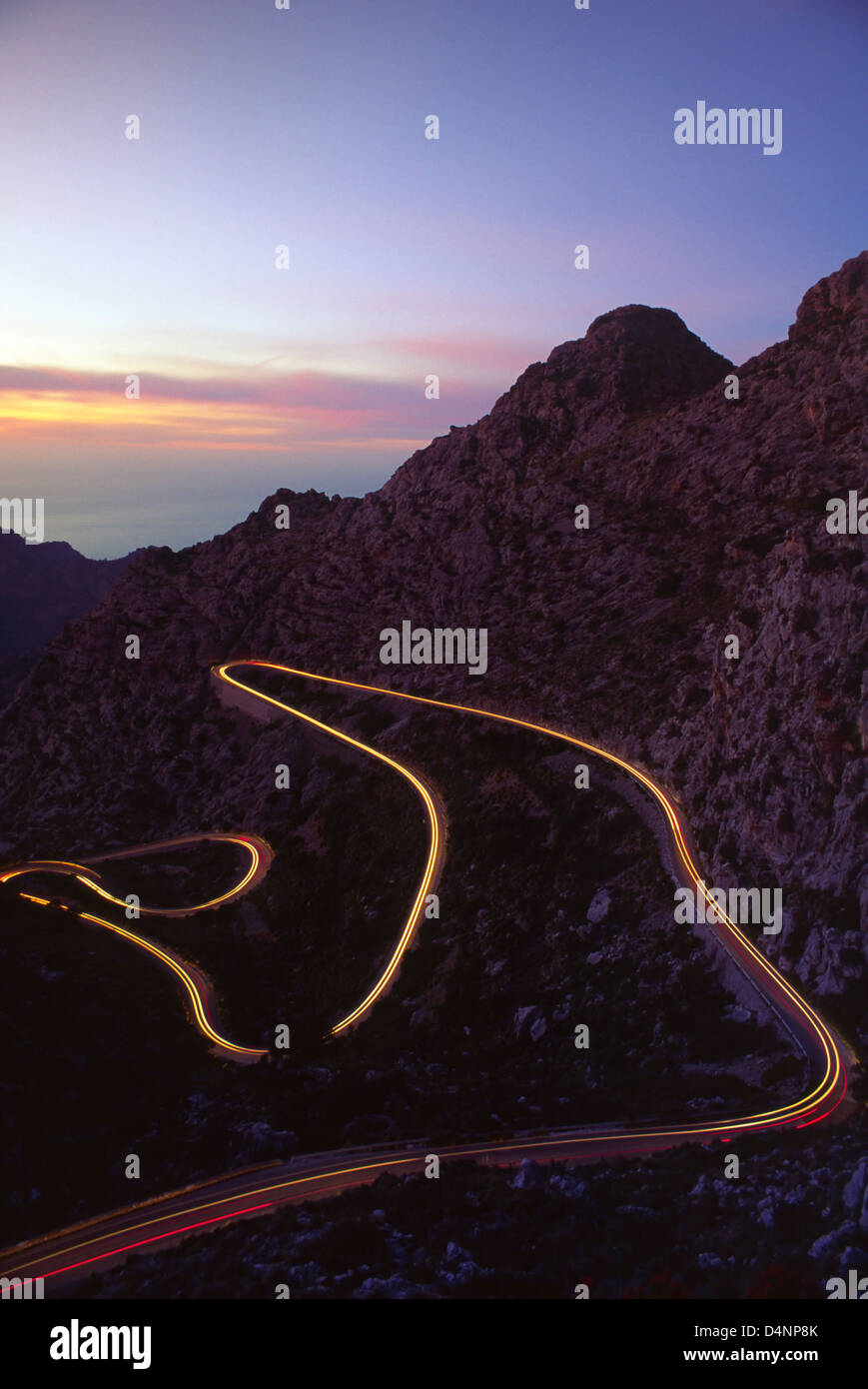 Light trails from a car on the mountain road to Sa Calobra, Mallorca, Balearic Islands, Spain. - Stock Image