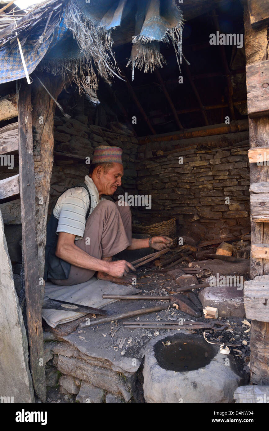 Traditional Nepalese village Blacksmith, at work in his Forge - Stock Image