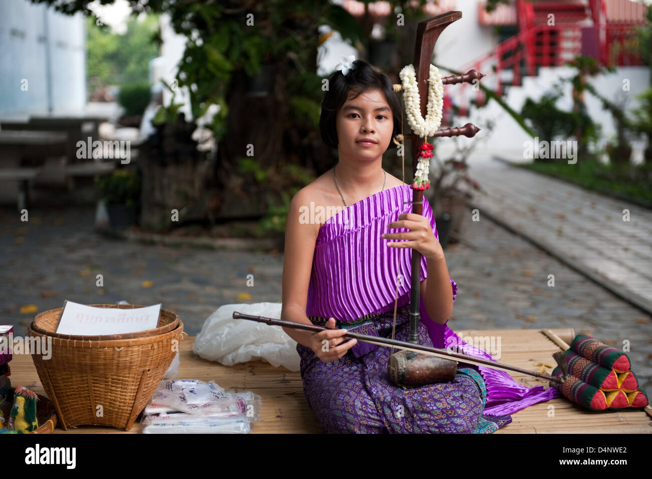Ayutthaya, Thailand, a young musician with a traditional stringed instrument - Stock Image