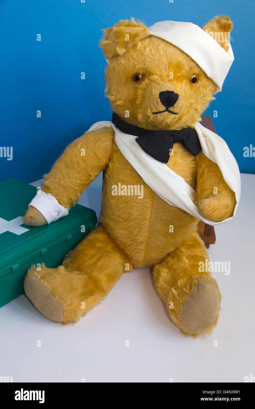 Teddy v stock photos teddy v stock images alamy teddy bear vintage well worn with first aid stock image altavistaventures Choice Image