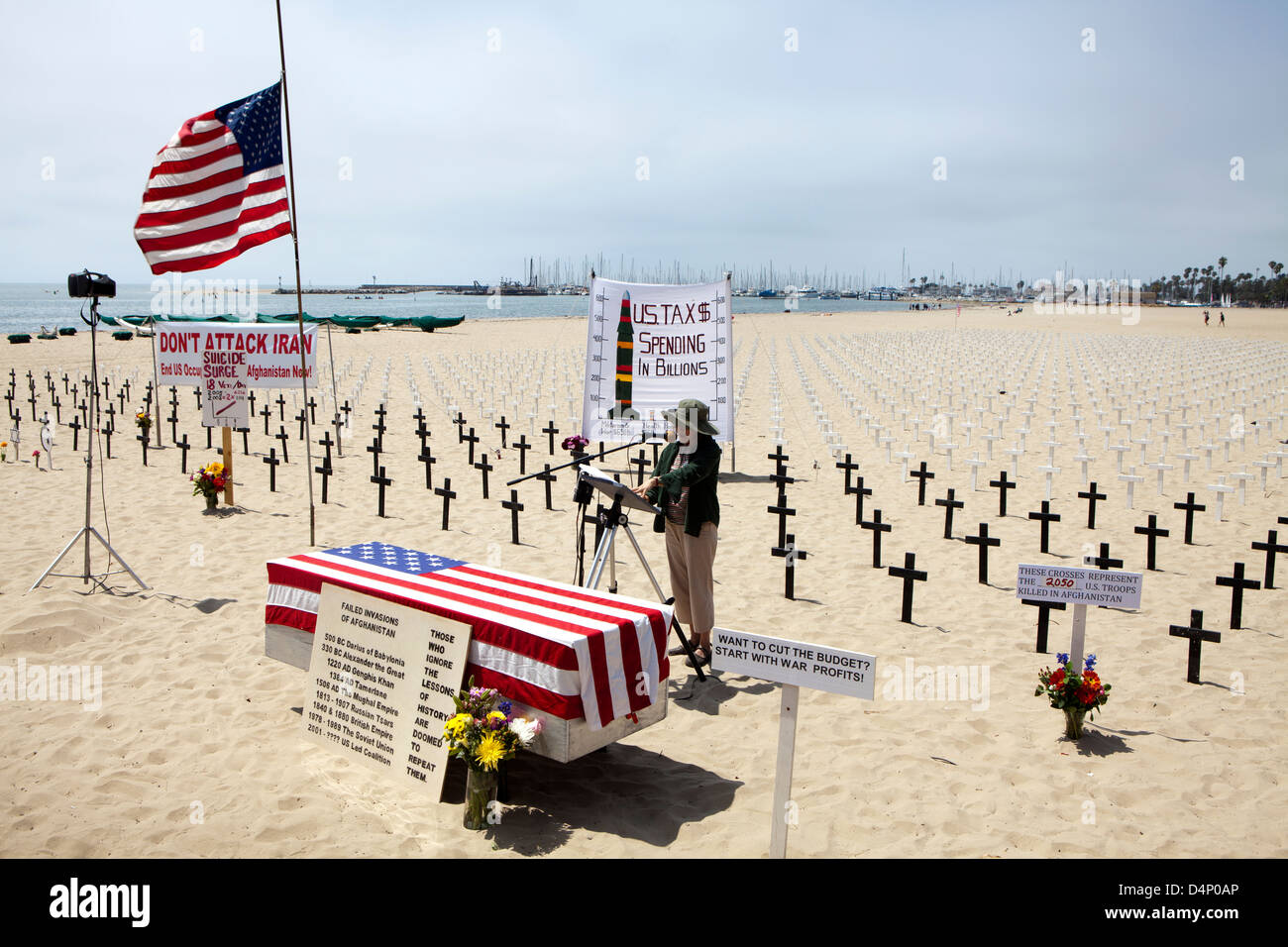 A coffin with crosses in the background at  the memorial Arlington West Santa Monica, a project of Veterans for - Stock Image
