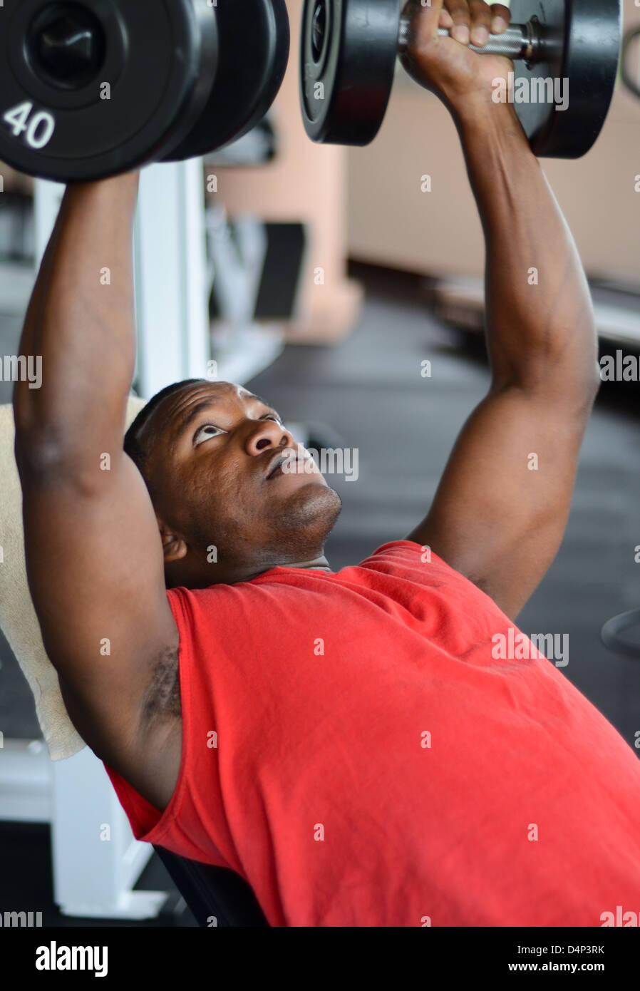 An African American man at the gym working out - Stock Image
