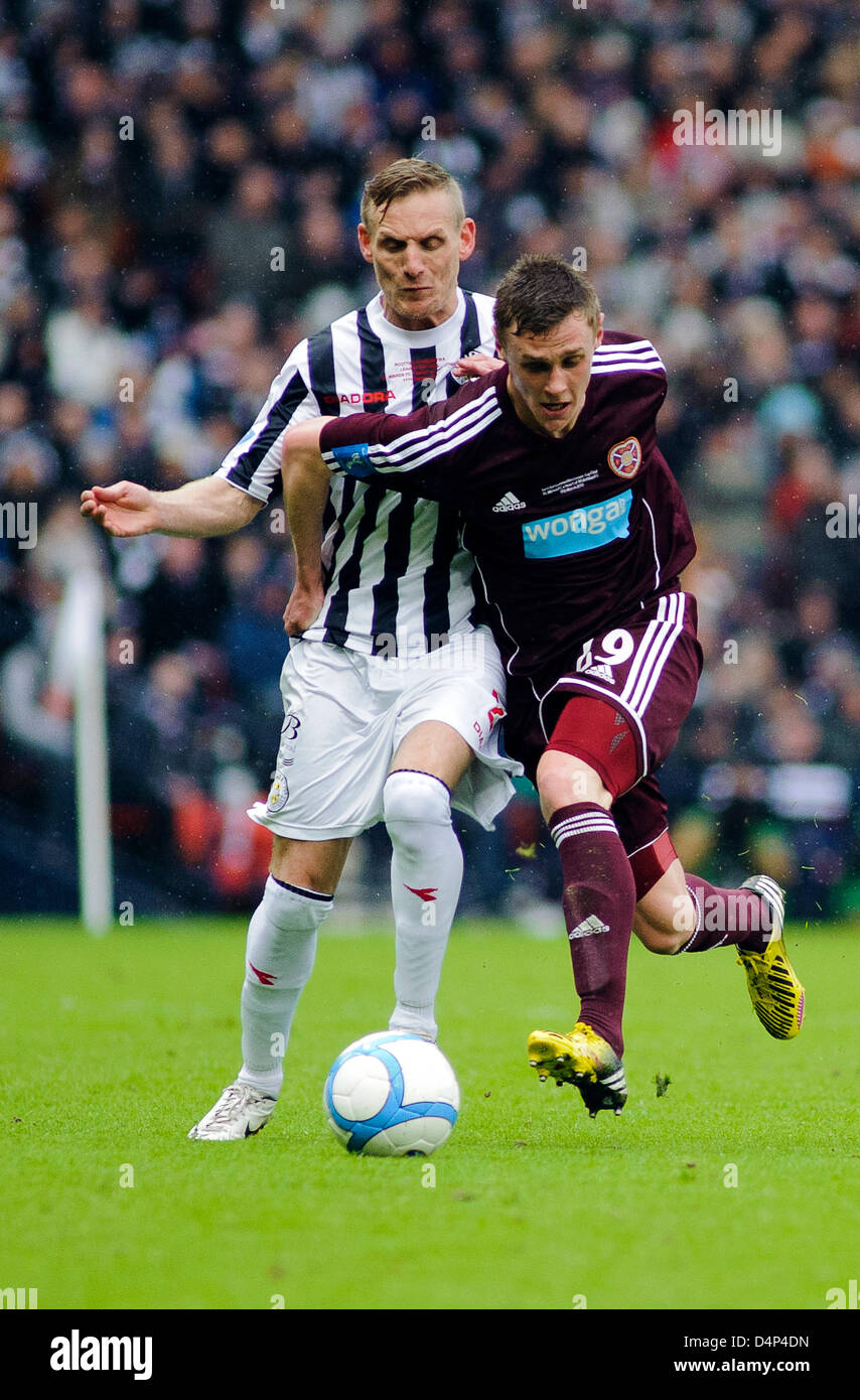 Glasgow, Scotland, UK. Sunday 17th March 2013. Kevin McHattie (29) holds off Gary Teale during the Scottish Communities - Stock Image