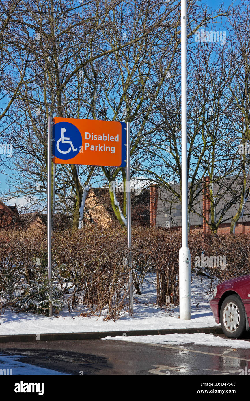 Disabled parking sign in a supermarket car park - Stock Image