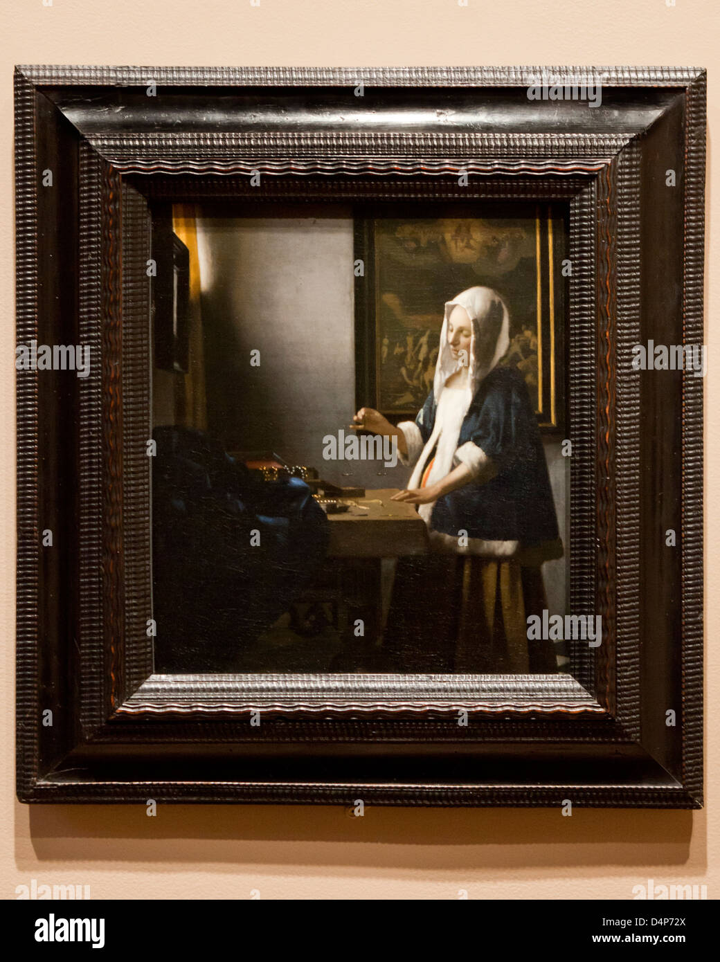 Woman Holding a Balance by Johannes Vermeer, 1664 - Stock Image