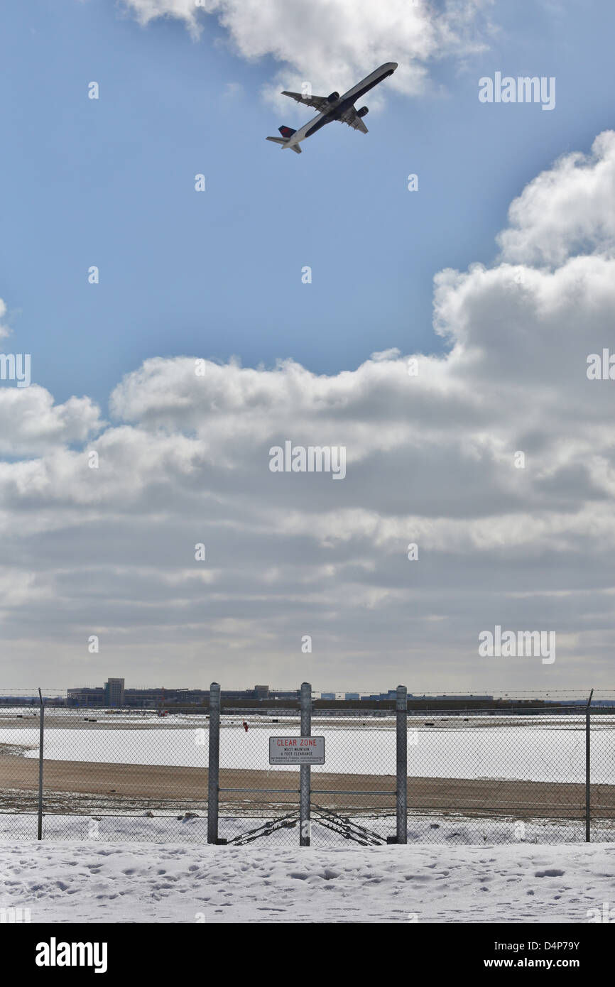 A security fence surrounding an airport. - Stock Image