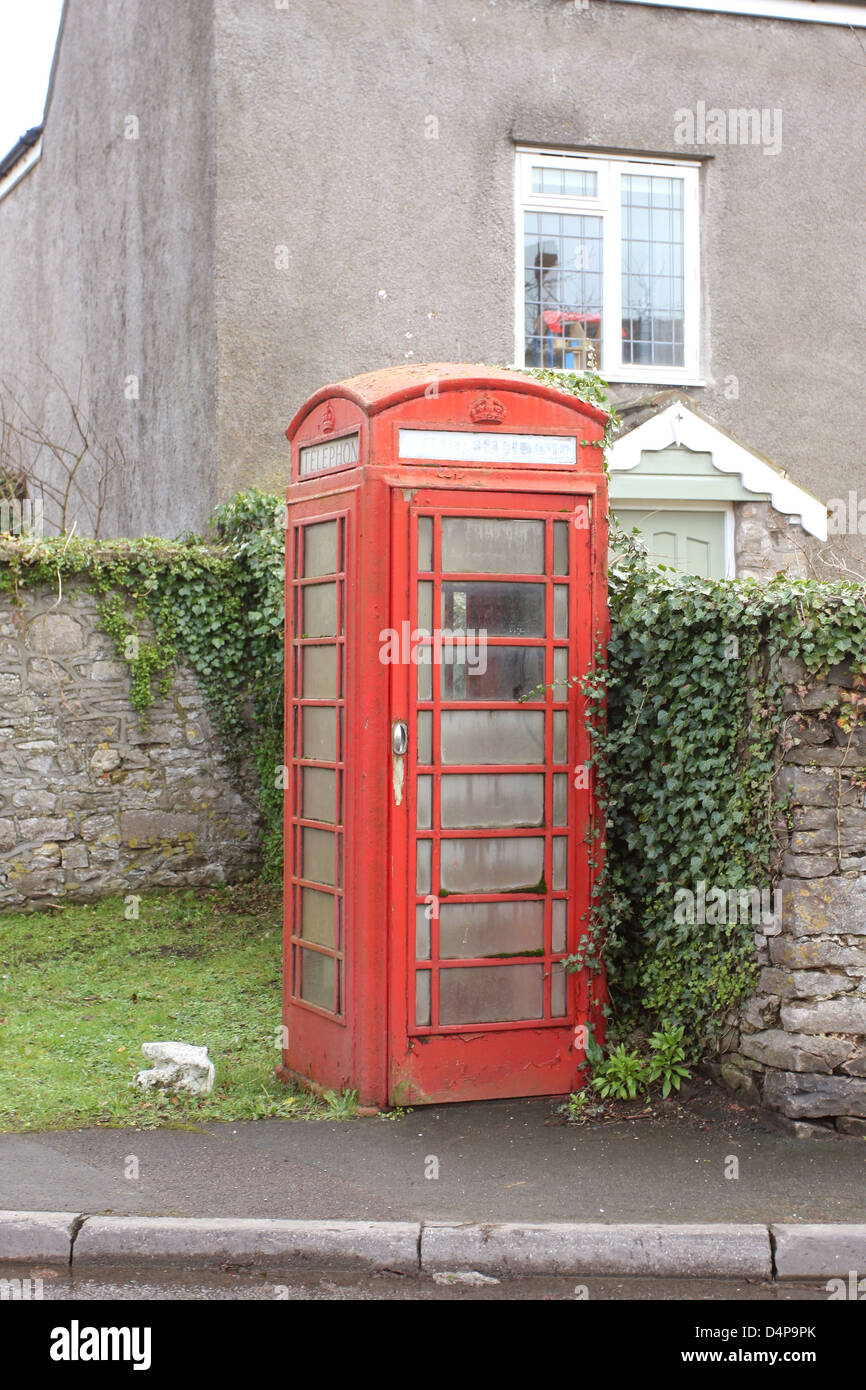 Traditional red British telephone box, now falling into disuse with everyone carrying a mobile phone, February 2013 - Stock Image