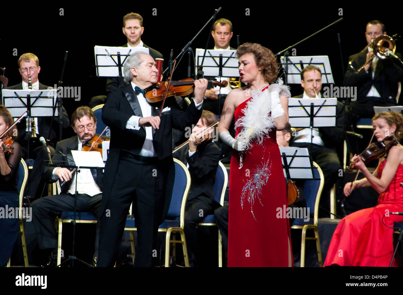 Conductor Peter Guth, singer Monica Mosser and Strauss Festival Orchestra Vienna in concert Crocus City Hall. Moscow - Stock Image