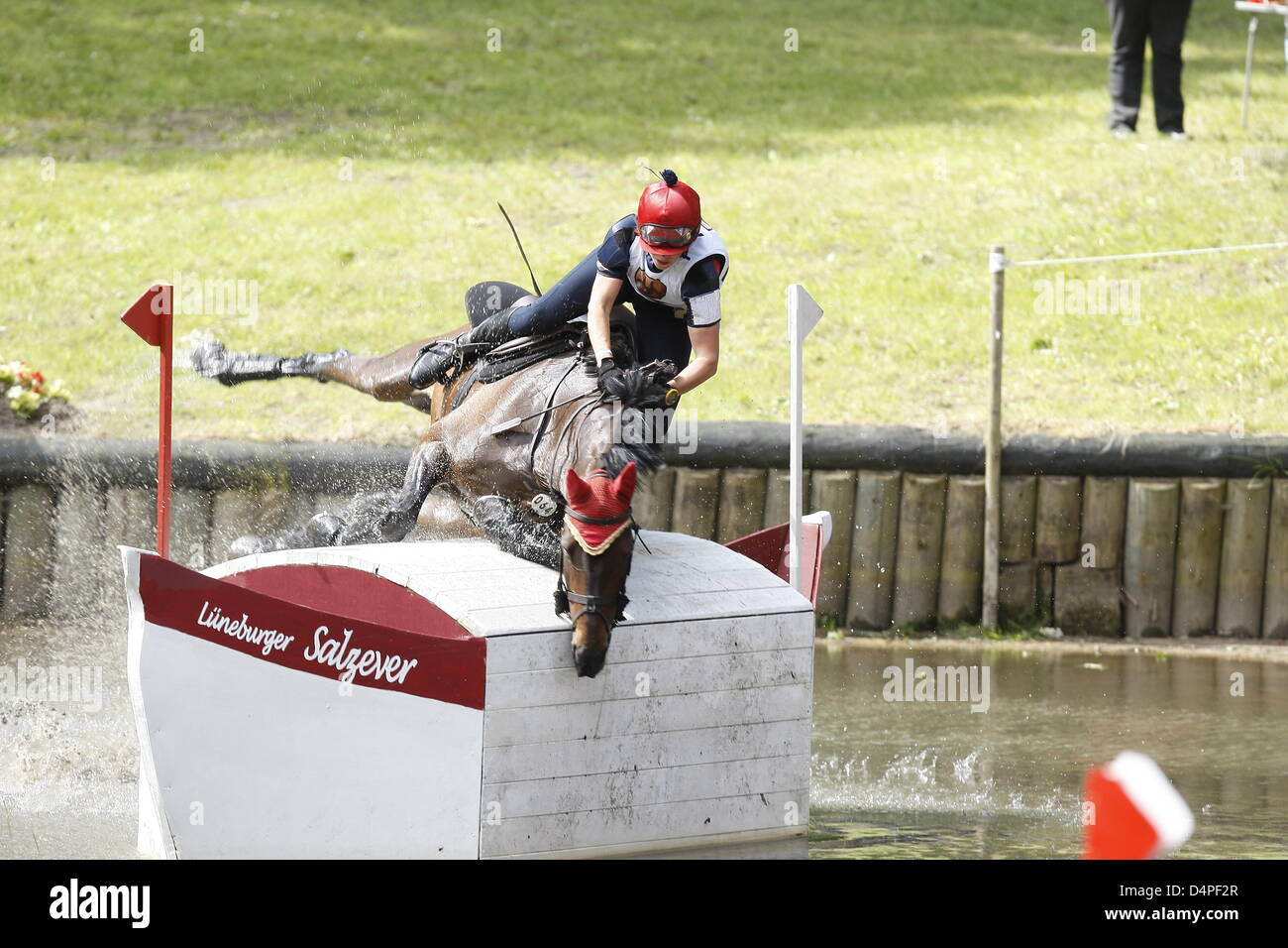 Dutch rider Merel Schurink and her horse ?Magee of Ireland? fail to clear an obstacle during the ?Three Stars Cross - Stock Image