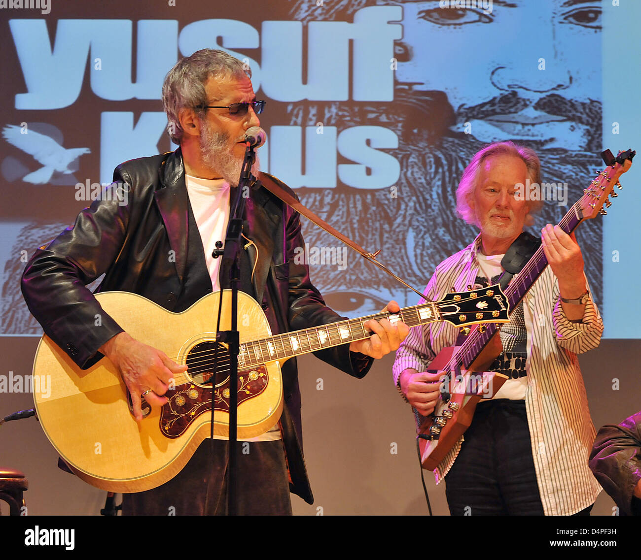 German bassist Klaus Voormann (R) and British musician Yusuf Islam, formerly known as Cat Stevens, perform at Voormann?s - Stock Image