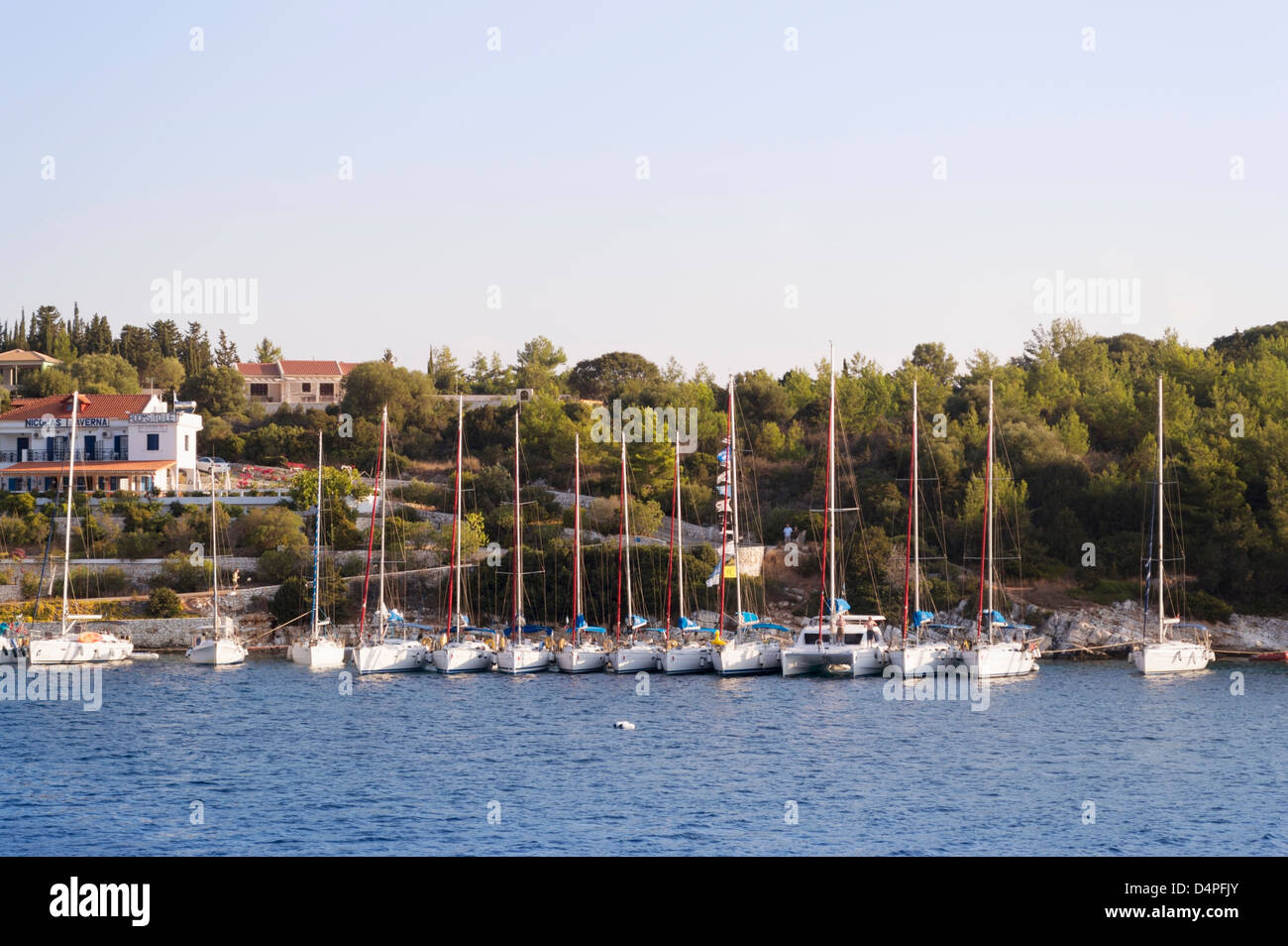 Cephalonia, Greece: Flotilla of yachts moored at the fishing port of Fiskardo in the north of Kefalonia - Stock Image