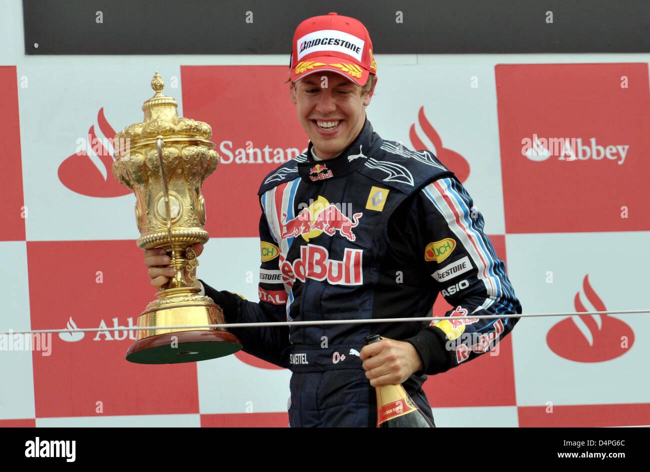 Winner of the race, German Formula One driver Sebastian Vettel (R) of Red Bull celebrates on the podium after the - Stock Image