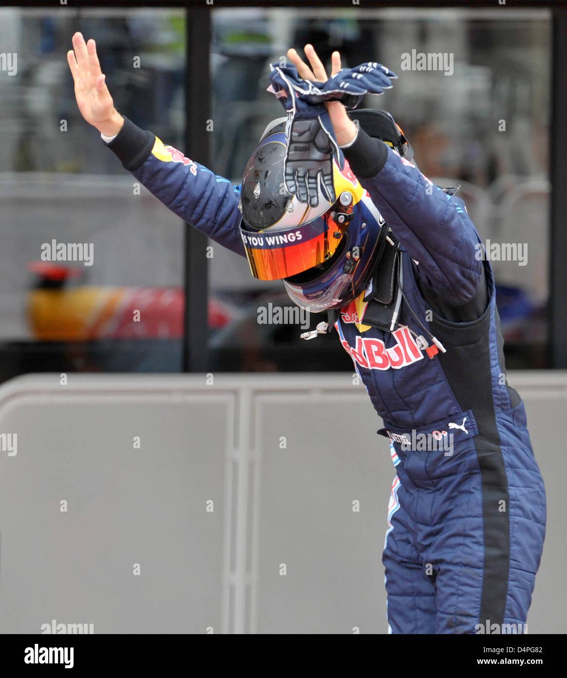 Winner of the race, German Formula One driver Sebastian Vettel (R) of Red Bull celebrates after the Formule One - Stock Image