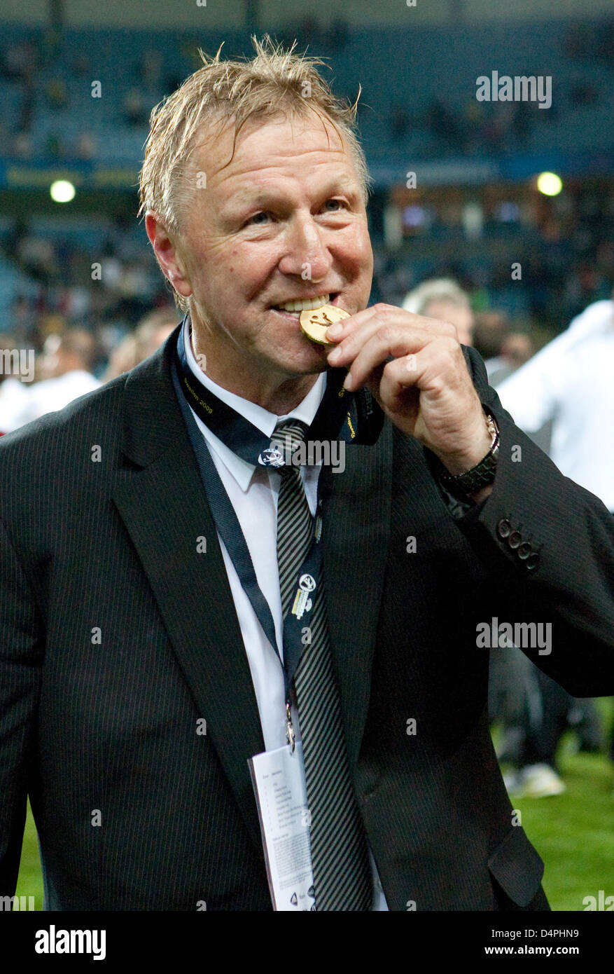 germany?s under-21 head coach horst hrubesch verifies the medal for