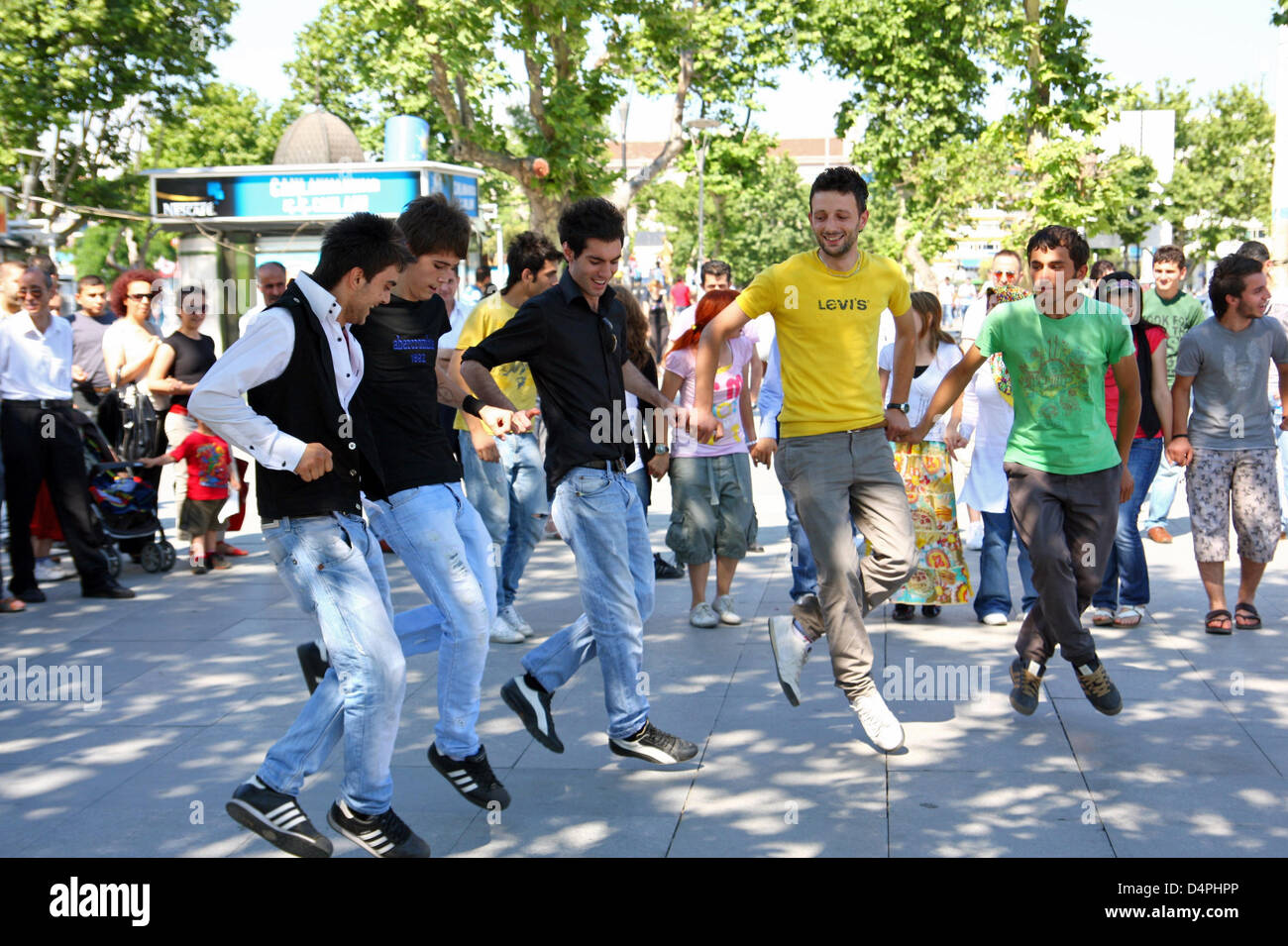 Young men dance the Kobasti to fast music in Istanbul, Turkey, 14 June 2009. The dance that reminds a little of - Stock Image