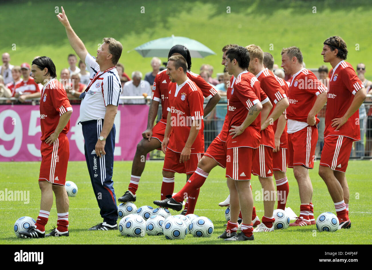 Louis van Gaal (2-L), new head coach of German Bundesliga soccer club FC Bayern Munich, is pictured with his players Stock Photo