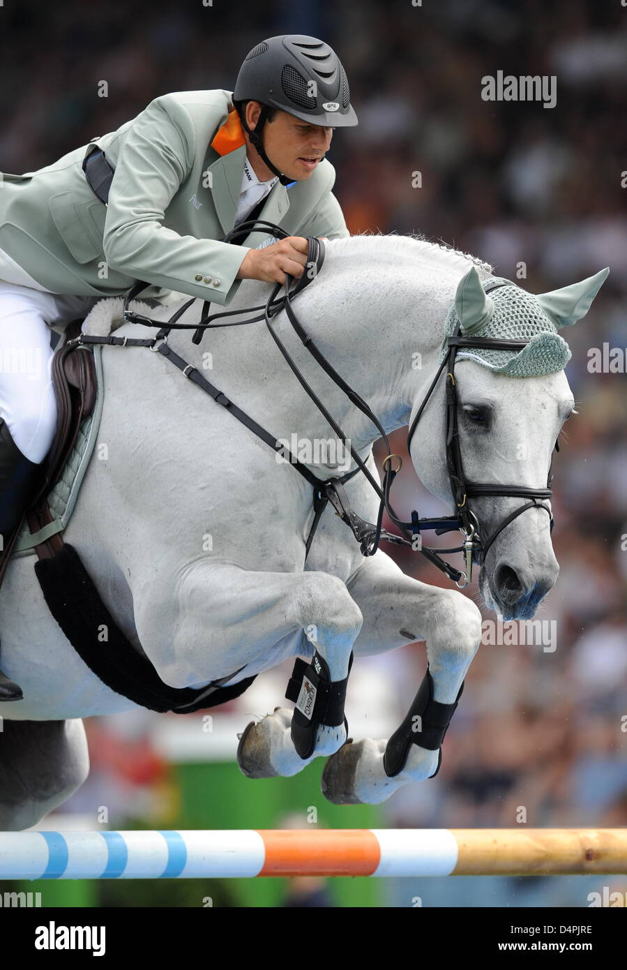 Germany?s jumping equestrian Marco Kutscher and his horse ?Cornet Obolensky? overcome an obstacle at the World Equestrian Stock Photo