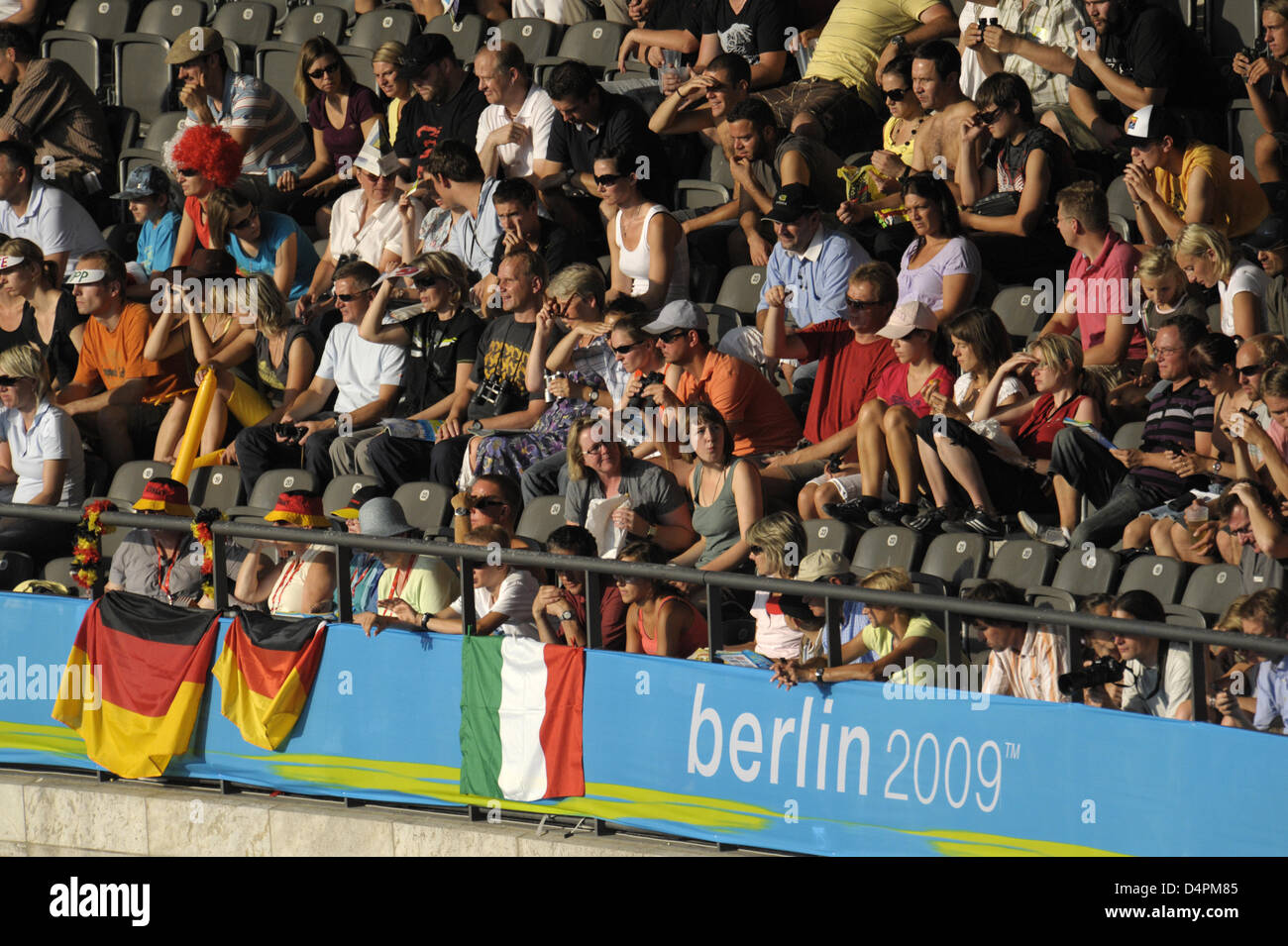 Spectators sit on the stands at the 12th IAAF World Championships in Athletics at the Olympic Stadium in Berlin, - Stock Image
