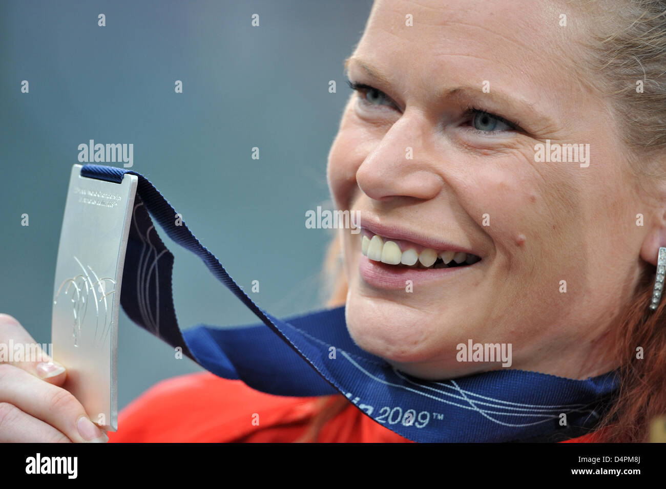 Germany?s Nadine Kleinert smiles with her silver medal won in the Shot Put at the 12th IAAF World Championships - Stock Image